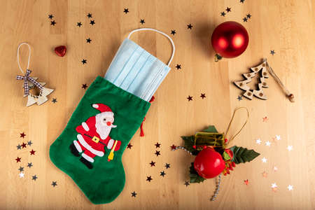 Photo for Coronavirus and christmas concept on wooden background - Royalty Free Image