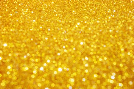 Photo pour Defocused abstract colorful twinkle light background.  Gold glittery bright shimmering background use as a design backdrop. - image libre de droit