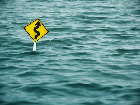yellow sign of road in water