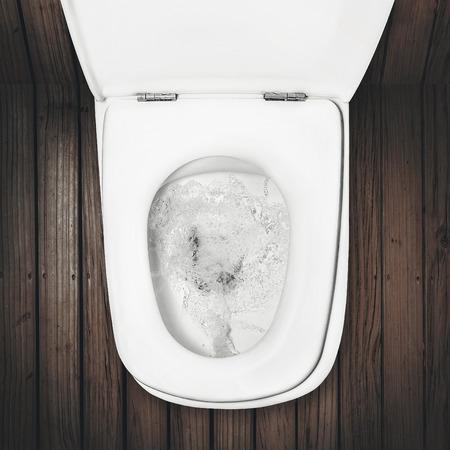 Foto de a flush toilet on wood floor - Imagen libre de derechos