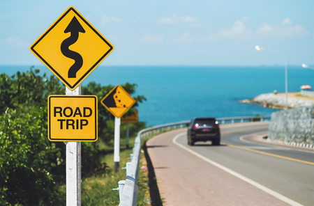 Photo for road trip word and curvy road sign - Royalty Free Image
