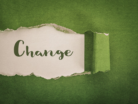 Foto de change concept, green paper torn background - Imagen libre de derechos