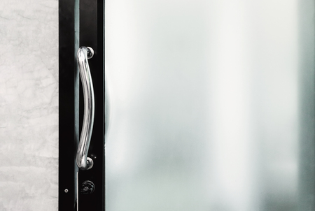 Photo pour handle and lock of frosted glass door - image libre de droit