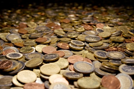 Coins all over the place. Shallow depth of field.