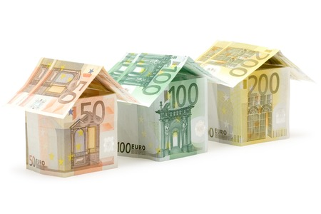 Three colorful houses built of different euro bills. Isolated on a white background.