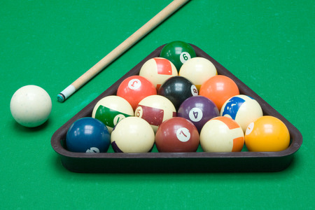Cue, triangle and colorful balls ready to play.