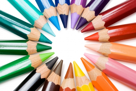 Colored pencils forming a color circle. White background.