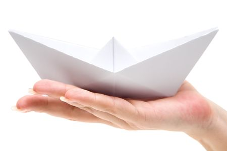 Woman holding a folded paper boat. Isolated on a white background.