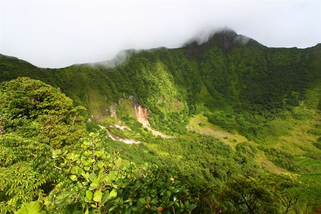The Crater below cloud covered Mount Liamuiga on Saint Kitts
