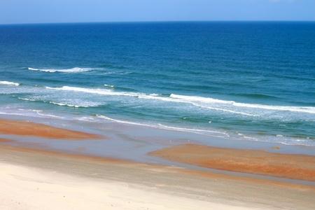 Waves crash along the coast on a beautiful day in Daytona Beach Florida
