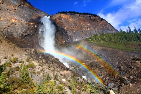 Double rainbows in the mist below Takakkaw Falls of Yoho National Park in Canada