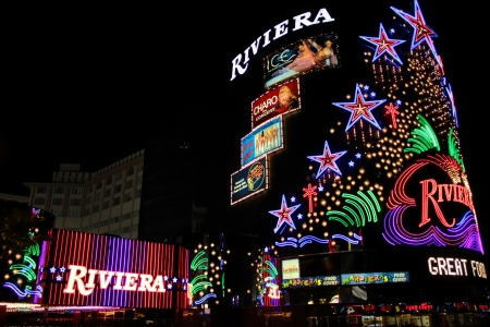 Las Vegas, USA - August 26, 2009: The Riviera Hotel and Casino is one of the first flashy hotel casinos to open on Las Vegas Boulevard in 1955.  Seen here is the brightly decorated sign near the main entrance to the building.