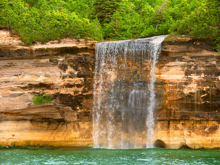 Spray Falls plunges into Lake Superior at Pictured Rocks National Lakeshore Michigan