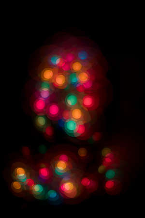 Photo for Blurred Christmas lights in the dark - Royalty Free Image