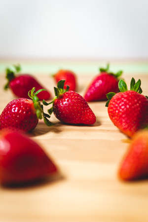 Photo for The sweet red strawberries on a wooden table - Royalty Free Image