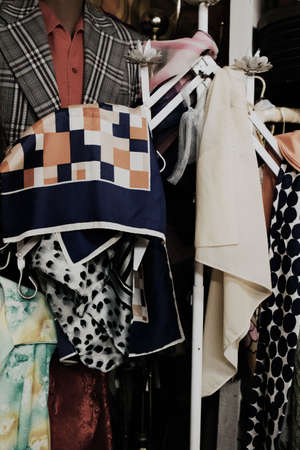 Foto per A closeup interior look of a clothing thrift shop in a suburban area of the city - Immagine Royalty Free
