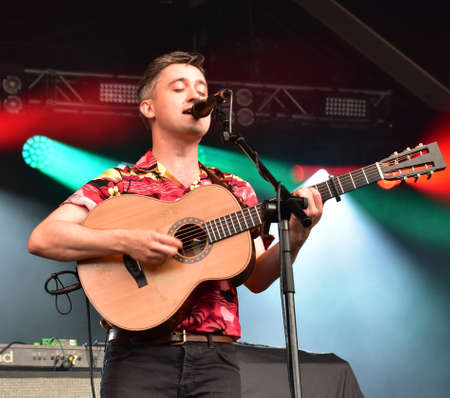 Foto de BRISTOL, ENGLAND, UNITED KINGDOM - Jun 29, 2019: Irish indie folk band Villagers in performance at the Bristol  Sounds Festival, Bristol, England. June 29 2019. - Imagen libre de derechos