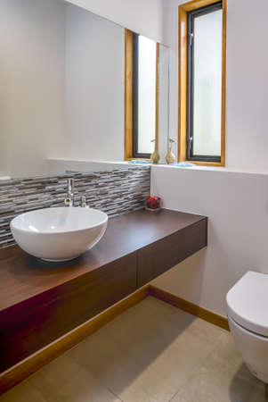 Photo pour A vertical shot of the modern sink in the bathroom of an apartment - image libre de droit