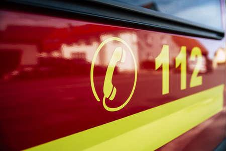Foto für German red Firetruck with emergency alarm dial number - Lizenzfreies Bild