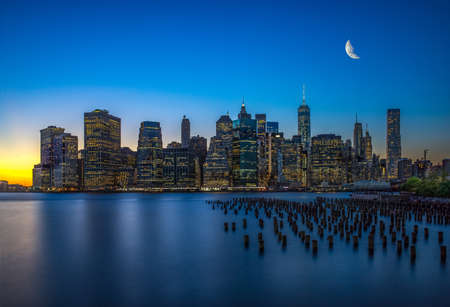 Photo for The evening Manhattan skyscrapers and water with reflection in it - Royalty Free Image