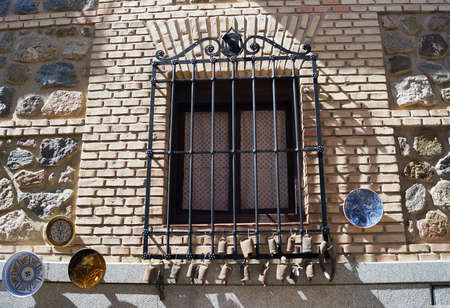 Photo pour A shot of black window security bars made out of steel in Toledo, Spain - image libre de droit