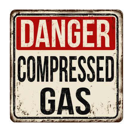 Photo pour A vintage caution sign of Danger Compressed Gas on a white background - image libre de droit
