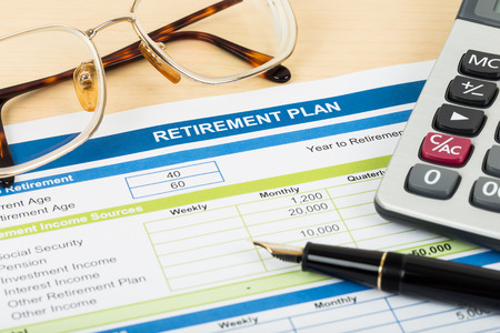 Retirement plan with glasses pen and calculator document is mockup