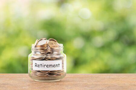 Photo pour Money coin jar on white background retirement saving concept - image libre de droit