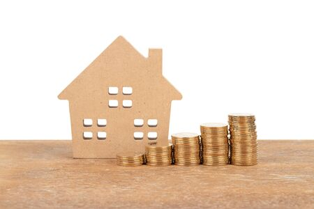 Photo pour Model house and coin stack on white background mortgage saving concept - image libre de droit