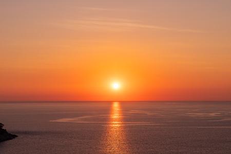 Photo pour Beautiful sunset on Andaman sea at Windmill View Point near Laem Promthep Cape, Phuket, Thailand - image libre de droit