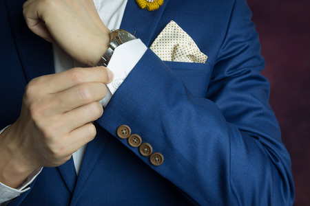 Photo pour Man in blue suit two bottons, doing button, close up - image libre de droit