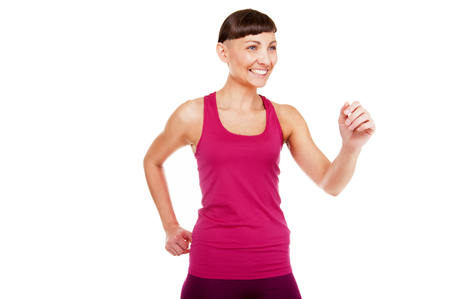 Young running woman in fitness outfit, running to aside. Isolated on white background.