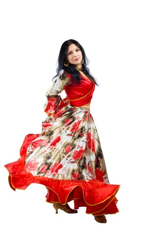 Mature woman dance in gypsy costume isolated