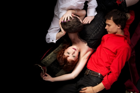 red woman and two men love triangle - decadence style