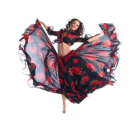 young Beauty woman jump in gypsy dance isolated