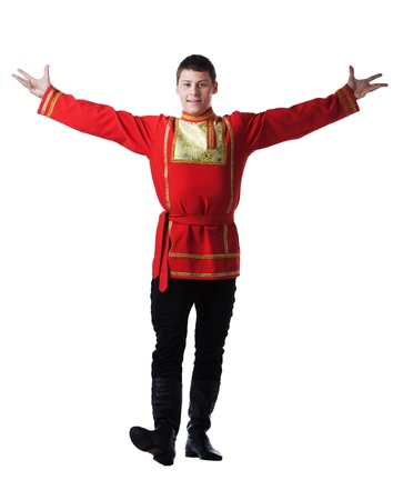 Full length portrait of dancer in traditional russian costume  Isolated on white