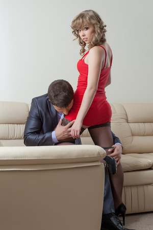 Image of businessman kissing pretty girl in erotic dress