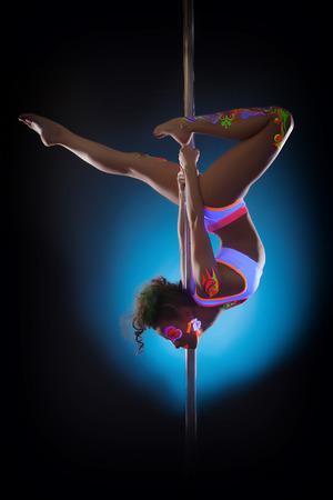 Shot of attractive go-go dancer posing on pylon