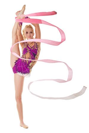 Free callisthenics. Lovely gymnast dancing with ribbon