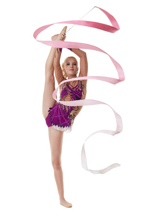 Image of charming artistic gymnast dancing with pink ribbon