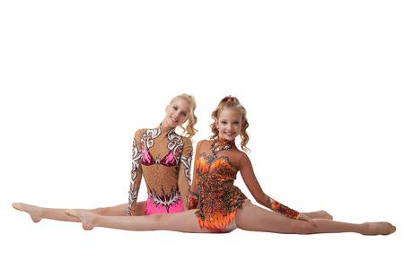 Image of flexible artistic gymnasts posing at camera