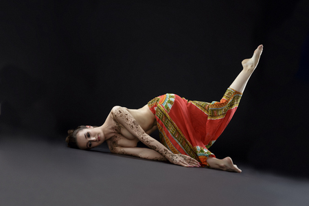 Mehendi and yoga. Studio photo of woman doing asana in studio