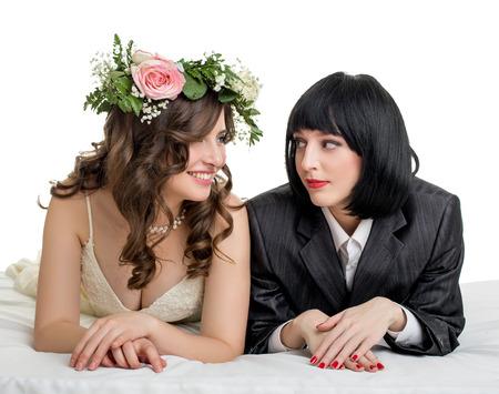 Foto de Same-sex marriage. Studio photo of girls dressed as bride and groom - Imagen libre de derechos