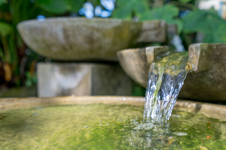 Photo for Tropical garden. Image of stone bowl with water flowing. Thailand - Royalty Free Image