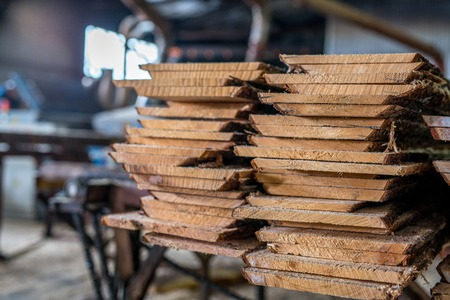 Woodworking plant. Image of boards stacked in pile