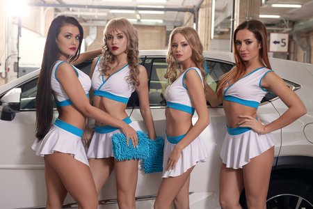 Photo for Models washing car at carwah service - Royalty Free Image