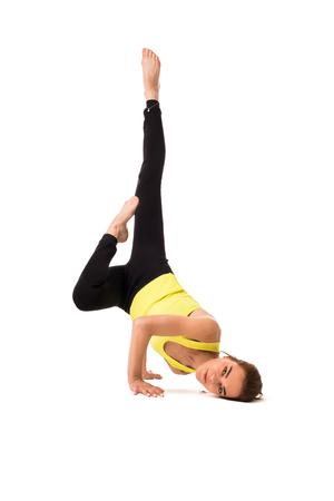Pretty brunette practising yoga isolated shot