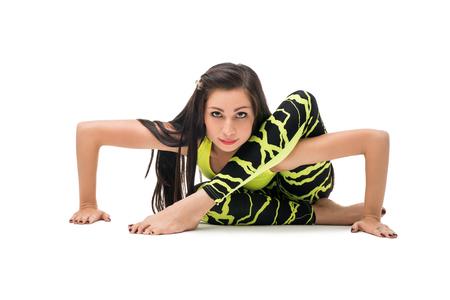 Beautiful brunette practising her yoga routine