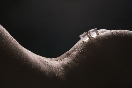Photo for Ice cubes lying on woman body cropped shot - Royalty Free Image