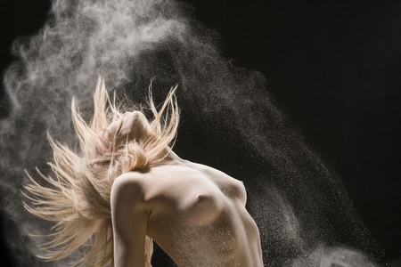 Nude blonde cropped shot in white dust cloud